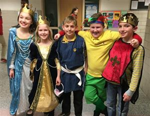 Students dressed in costumes for performance