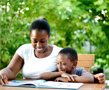 mom and boy reading